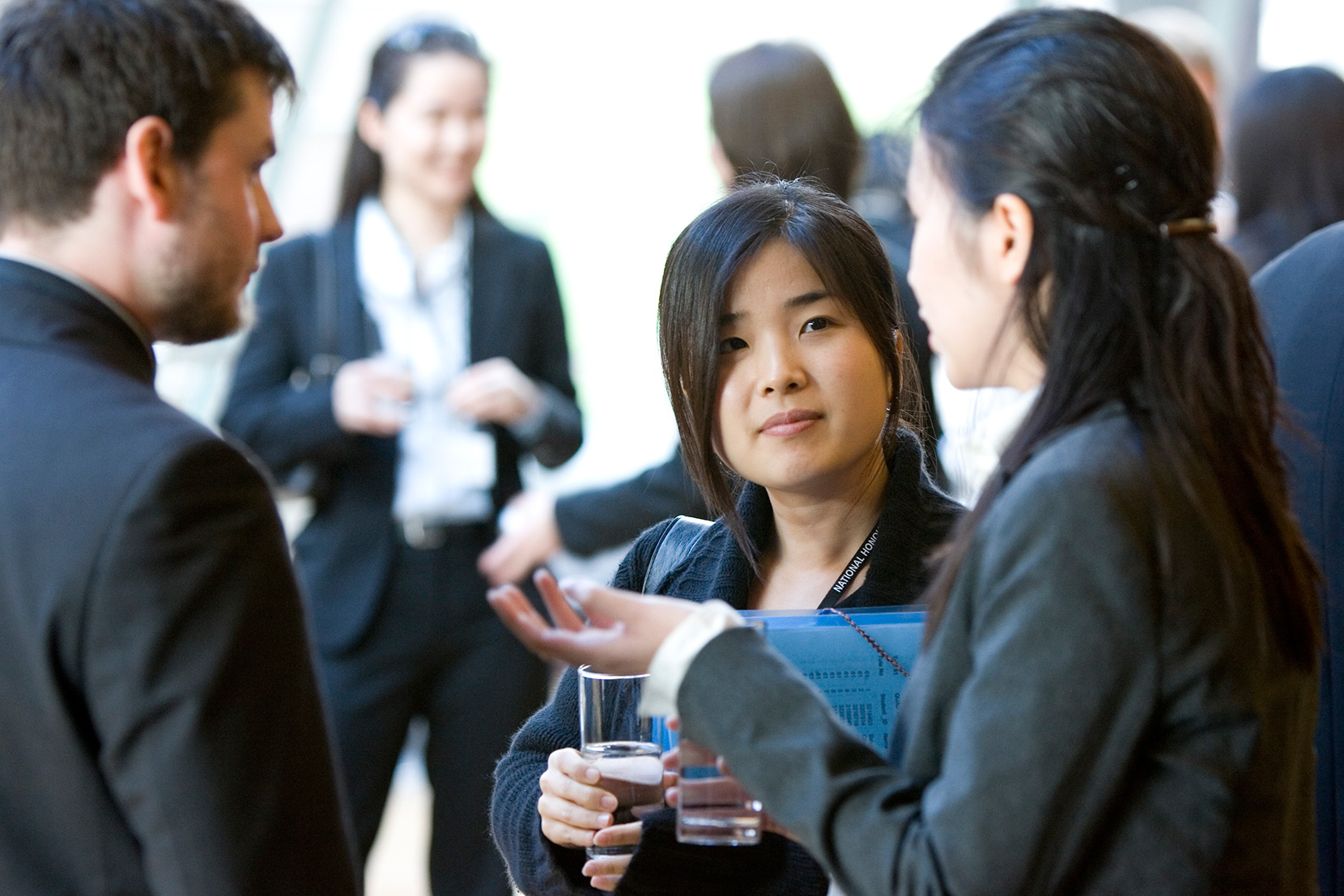 Students talking at an event